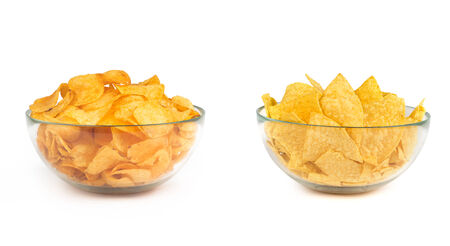 nacho: two bowls of potato and nacho chips isolated on white background