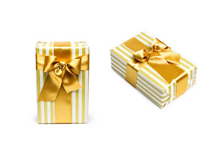 duo tone: Gift boxes in gold duo tone with golden satin ribbons