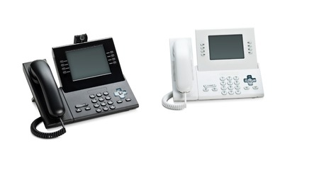 Office IP telephone set with LCD display isolated on white photo