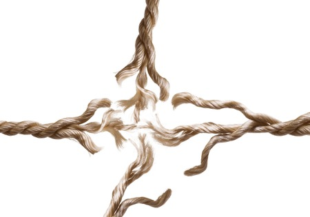 Close up of a breaking rope on white photo