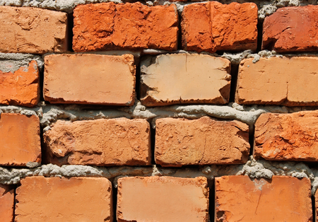 Detail of brick wall with bricks of different colors photo