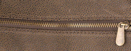 Brown leather texture and zipper background photo