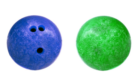 bowling strike: blue and green marbled bowling balls isolated Stock Photo