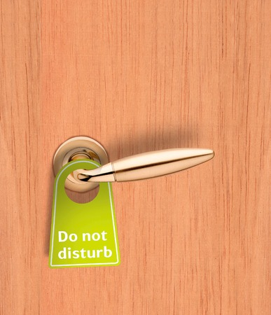 quietness: Hotel wood door with a Do not disturb sign