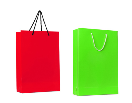 gift spending: red and green shopping bags isolated Stock Photo