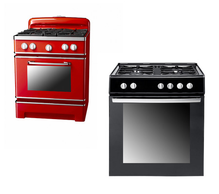 old gas stove: black and red gas cooker over the white background