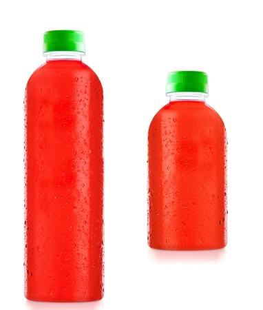 regimen: bottles fruit juice with drops of water isolated Stock Photo
