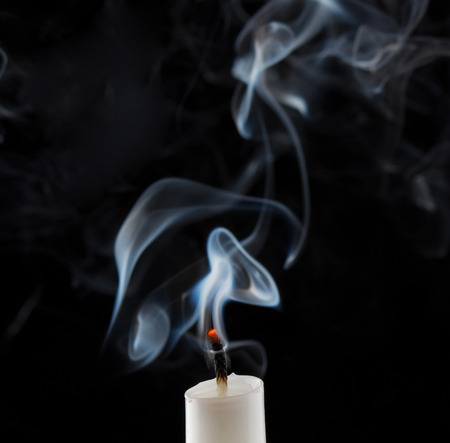white candle: Extinguished candle with smoke
