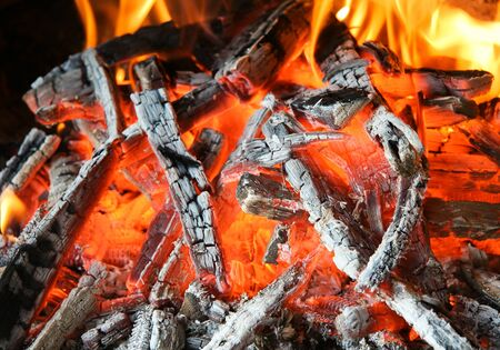 smolder: background from a fire, conflagrant firewoods and coals Stock Photo