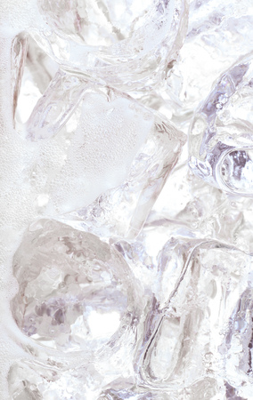 carbonation: Close up of ice cubes in water or soda Stock Photo