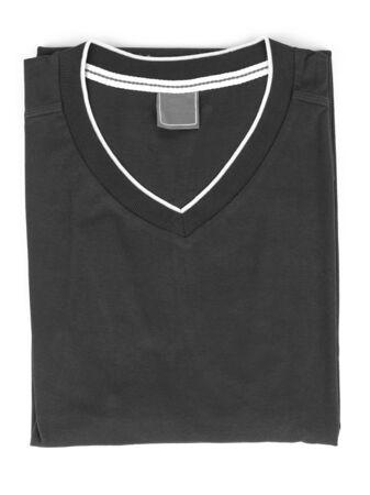 camisa: plegado de la camiseta en el fondo blanco Foto de archivo