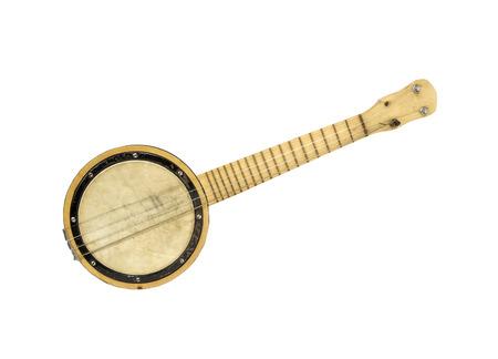 Vintage four String Banjo isolated on white Stock Photo