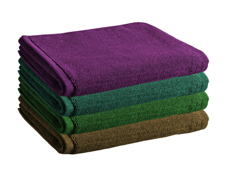 Pile of colored towels isolated Stock Photo