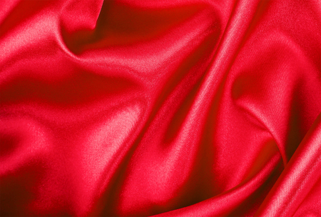 red satin or silk fabric isolated