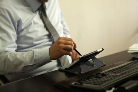digitized: Man using tablet pc Stock Photo