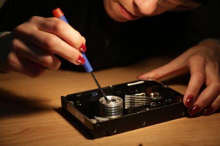hard drive: Woman technician work on a hard drive