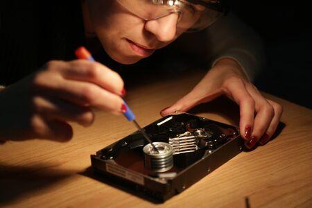 Woman technician work on a hard drive
