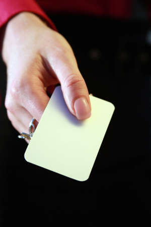 A hand holding a blank business card Stock Photo