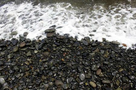 A beach shore of stones