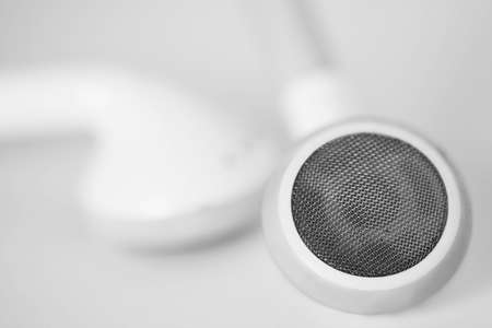 Macro close up of white headphones on a clean white background Banco de Imagens
