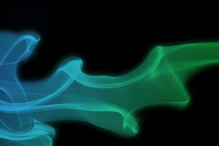 Blue and green smoke against a black background Stock Photo