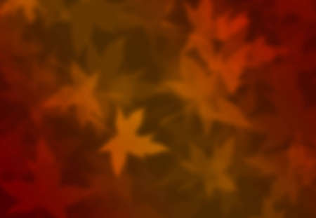 A blurred fall foliage background with red, yellow and orange leaves Stock Photo