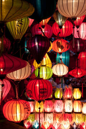 asian art: One of the numerous colorful paper lantern shops in Hoi An, Vietnam