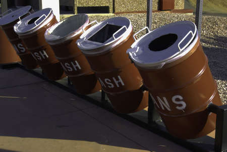 enviromental: Four Enviromental Recycle Barrels Stand Ready For Use Stock Photo