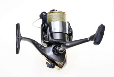 real leader: Sports fishing reel loaded with yellow braid line on whit