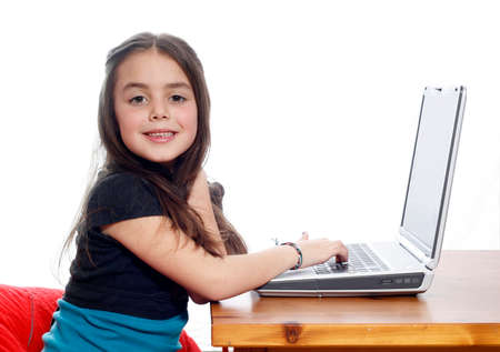 Young girl working on laptop and smiling Stock Photo - 1406045