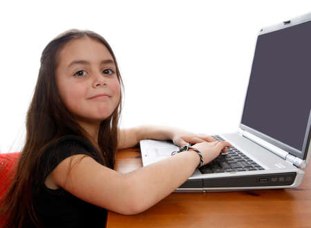 Young girl working on laptop and smiling Stock Photo - 1406063