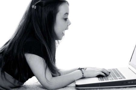 Young girl working on laptop and smiling Stock Photo - 1406037