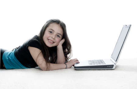 Young girl working on laptop and smiling Stock Photo - 1406060