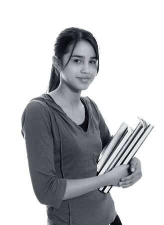Female university student smiling and carrying some notebooks - isolated over a white background photo