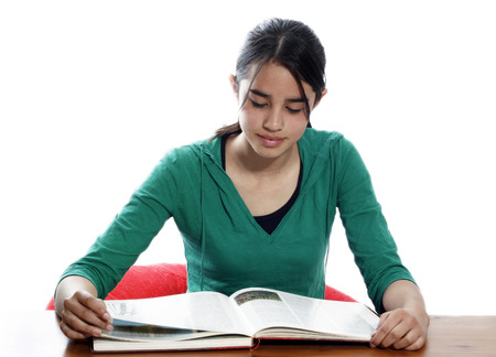 A young woman reading in the library photo