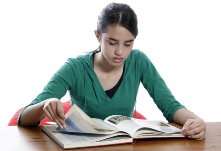 A young woman reading in the library Stock Photo - 1407090
