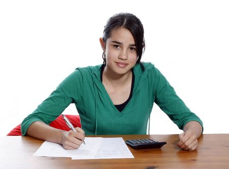 A young woman holding a pen, doing her taxes photo