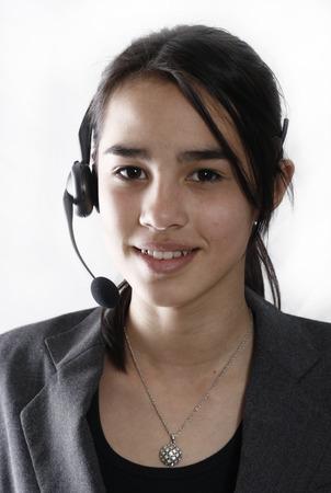 A friendly secretarytelephone operator at a call-center
