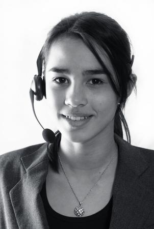 A friendly secretary/telephone operator at a call-center Stock Photo - 1407087