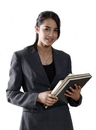 Female university student smiling and carrying some notebooks - isolated over a white background