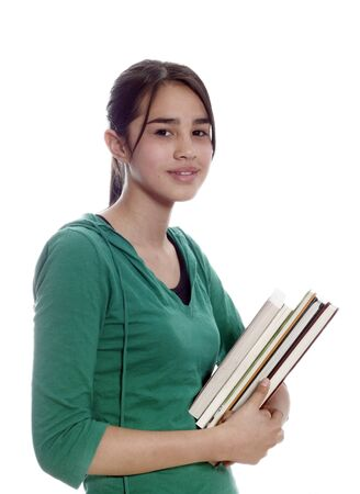 Female university student smiling and carrying some notebooks