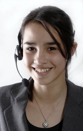 A friendly secretarytelephone operator at a call-center photo