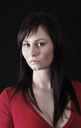 pretty girl in red top, black background Stock Photo - 1457299