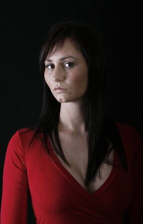pretty girl in red top, black background Stock Photo - 1457302