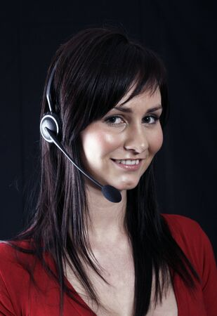 Customer service agent wearing wireless headset, on the phone Stock Photo - 1457320