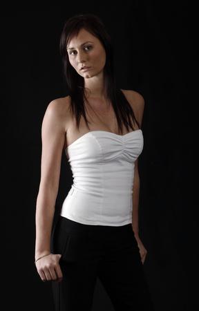Elegant girl in white top, black background Stock Photo - 1457284