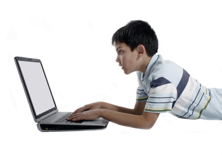 Young boy doing homework on a laptop Stock Photo - 1518695