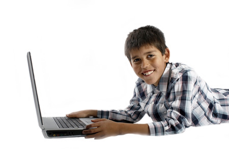 Young boy doing homework on a laptop