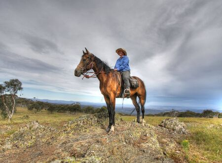 Women rider on a mountain Stock Photo - 2808924