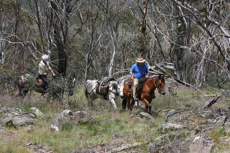 akubra: Riders going up a mountain